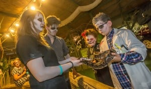 Dylan Kirby and Brooklyn Hennessy with a snake during Halloween Night at Reptile Village. Photo: Pat Moore.