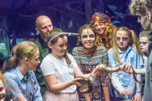 Evanna Minogue tries out handling a snake during the Halloween Night at the Reptile Zoo. Photo: Pat Moore.