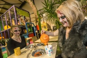 Nicola Whitty and Gilli Skelton enjoying tea and insects at the Halloween Night in the Reptile Village. Photo: Pat Moore.